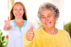 Elder and nurse showing thumbs up
